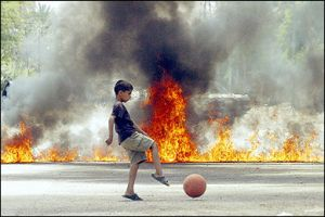 kid-with-ball-and-explosions.jpg